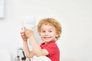 toddler at dentist office for check up of common pediatric dental issues