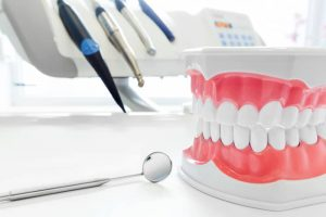 dental cleaning tools with model teeth